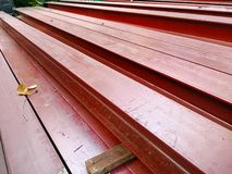 Pile of steel beam paint red color preparing for structure construction royalty free stock image