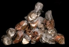 Pile of sterling coins in money bags Stock Images