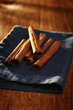 Pile of stick cinnamon on a napkin Stock Photos
