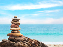 Pile of stone as pyramid on summer beach background. Pile of small stone as pyramid on summer beach background Royalty Free Stock Image