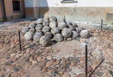 Pile of stone cannon balls in Novgorod kremlin, Russia Royalty Free Stock Photos