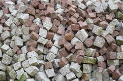 The pile of stone cobble. The pile of grey and rose stone cobble Royalty Free Stock Photos