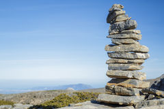 Pile of stone at the mountain. Stones pile at the mountain with blue sky at background Royalty Free Stock Image