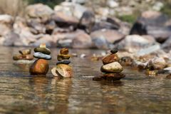 Pile of stone in River stock image