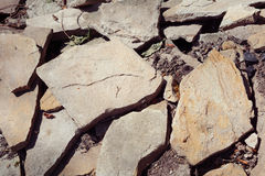 Pile of stones background. Heap of large beige stones and shivers Stock Photography