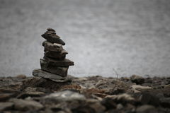 Pile of stones with defocused water background royalty free stock photography