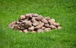 Pile of stones on field Royalty Free Stock Image