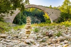 Pile of stones  and hunchback bridge Stock Photo