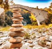Pile of stones  and hunchback bridge Royalty Free Stock Photo
