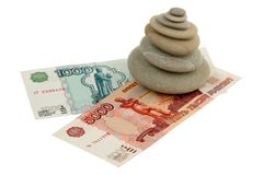 Pile of stones and money Royalty Free Stock Photo