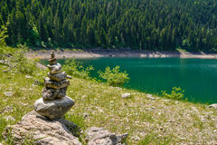 Pile of stones near Black Lake. Crno jezero in Durmitor National Park, Montenegro Royalty Free Stock Photos