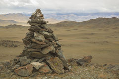A pile of stones ritual in Mongolia Royalty Free Stock Images