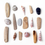 Pile of stones, sea shells flat lay closeup on white background. Tourism and travel holiday theme Stock Photo