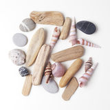 Pile of stones, sea shells flat lay closeup on white background. Tourism and travel holiday theme Royalty Free Stock Photos