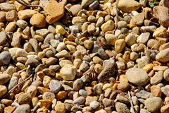 Pile of stones on the shoreline Stock Image