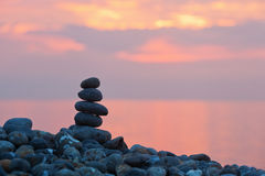 Pile of stones at sunrise Stock Images