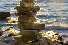Pile stones-sunset beach Stock Image