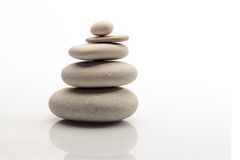 Pile of stones on white background and refflection Stock Photo