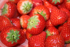 Pile of strawberries. Pile of bright red fresh strawberries Stock Photos