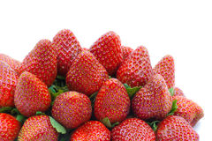 Pile strawberries isolated on white Stock Photography