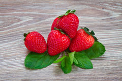 Pile of strawberry on wooden table Royalty Free Stock Image