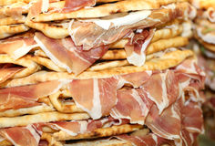 Pile of stuffed tortillas with ham for sale in Italy Royalty Free Stock Photo