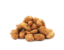 Pile of sugar coated peanuts isolated. Over the white background Royalty Free Stock Photo