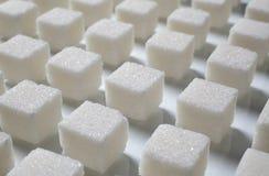 Pile of sugar cubes Stock Photos