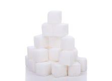 Pile of sugar. Isolated on white Stock Image