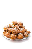 Pile of sugared oliebollen or fried fritters on dish Stock Photos