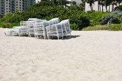 Pile sun loungers beach. There are pile of sun loungers on the beach in front of hotel ,in the morning , waiting the time , when one by one they will me occupied royalty free stock photos