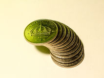 A pile of Swedish coins of one crown in green light Stock Images