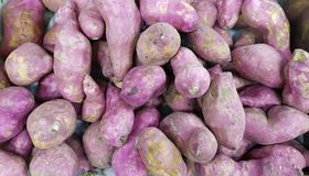 Pile of sweet potato in vegetable market for sale. In  a vegetable market Stock Photo