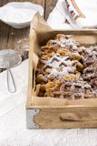 Pile of sweet potato waffles with sugar powder on a wooden tray royalty free stock photo