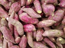 Pile of sweet potatoes. Full frame of sweet potatoes at market stock photos