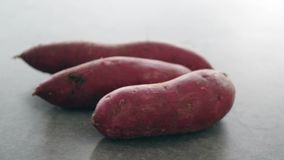 Sweet potatoes rotating. Pile sweet potatoes rotating, slow motion footage video stock video footage