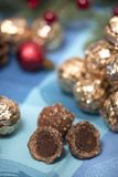 Pile of sweet round chocolate candies. For christmas celebrations on a table cloth Royalty Free Stock Photo