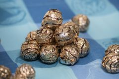 Pile of sweet round chocolate candies. For christmas celebrations on a table cloth Royalty Free Stock Photography