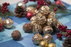 Pile of sweet round chocolate candies. For christmas celebrations on a table cloth Stock Image