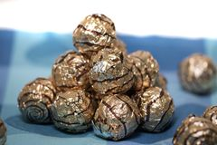 Pile of sweet round chocolate candies. For christmas celebrations on a table cloth Royalty Free Stock Image