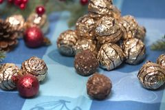 Pile of sweet round chocolate candies. For christmas celebrations on a table cloth Stock Photography