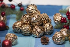 Pile of sweet round chocolate candies. For christmas celebrations on a table cloth Royalty Free Stock Images