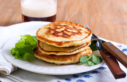 Pile of sweetcorn and herb pancakes Stock Photo