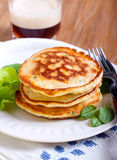 Pile of sweetcorn and herb pancakes Stock Photography
