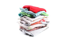 Pile of t-shirts. Isolated on white Stock Images