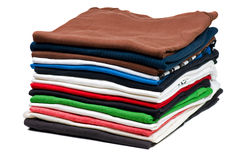 Pile of T-Shirts. Over white stock photos