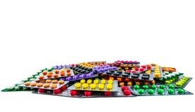 Pile of tablet pills isolated on white background. Yellow, purple, black, orange, pink , green tablet pills in blister pack. Pain. Killer medicine. Drug for stock image