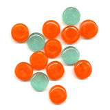 Pile of tablets. Pile of orange and green transparent tablets Stock Photos