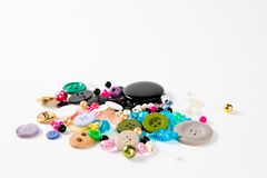 Pile of tailor`s knobs of many sizes. shapes and colors royalty free stock images