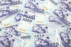 Pile of Taiwan dollar banknotes Stock Photos
